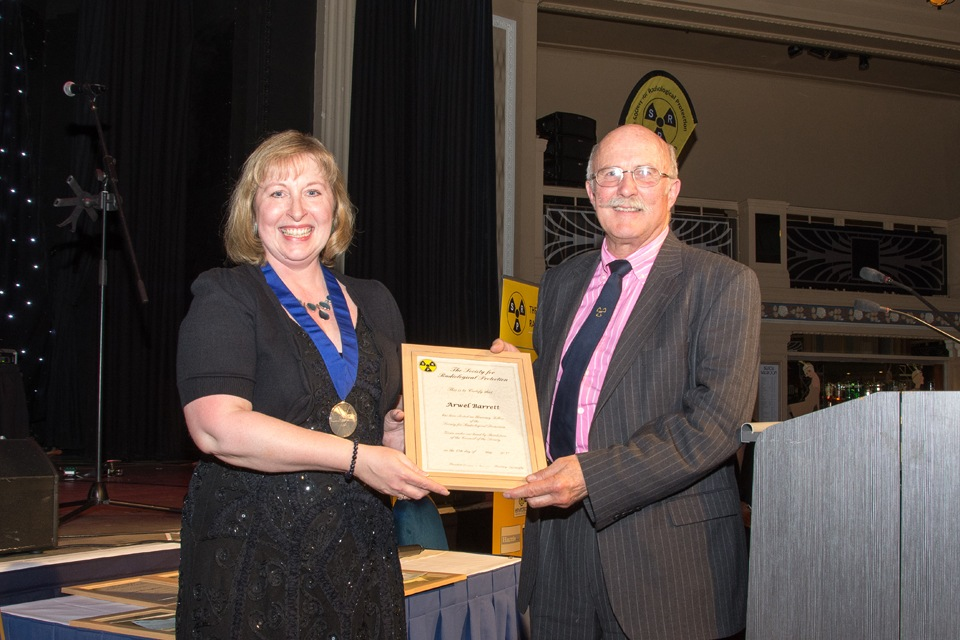 Arwel Barrett receiving Honorary Fellowship from Amber Bannon (SRP President)