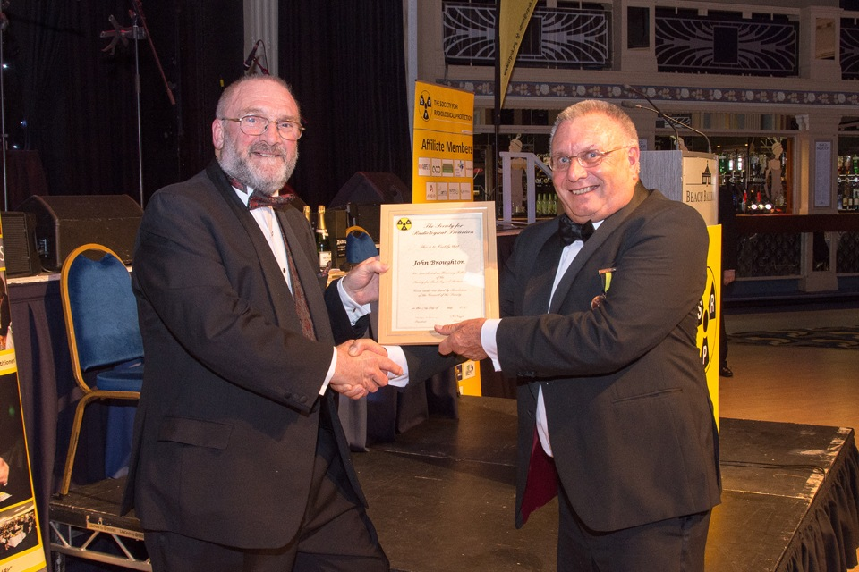 John Broughton receiving Honorary Fellowship from Alan Marsh (University of Cumbria)