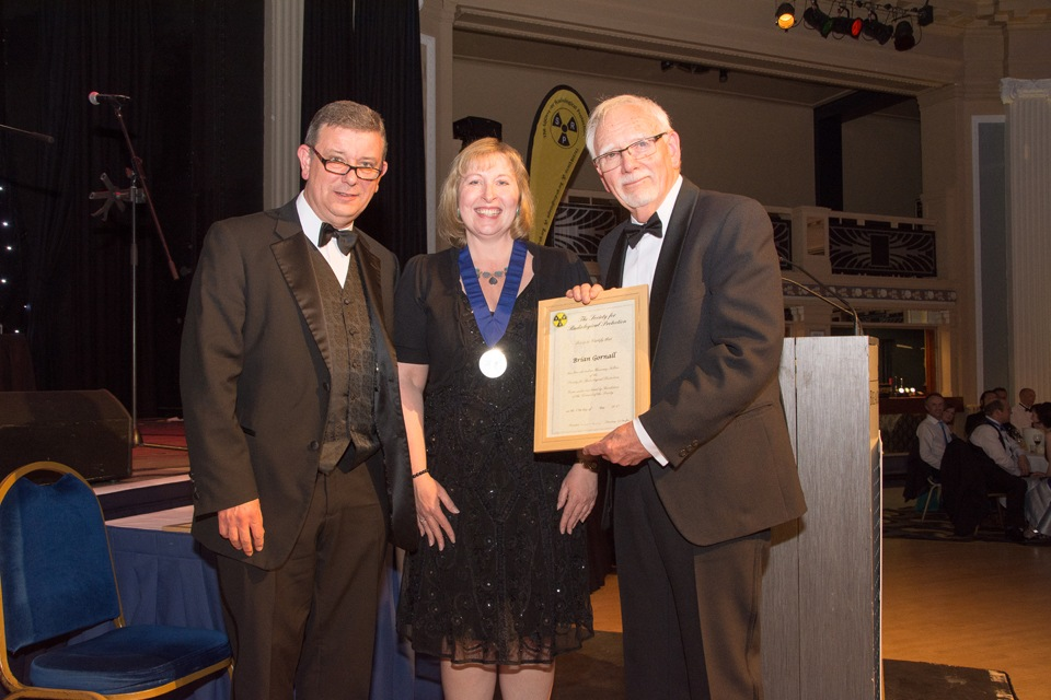 Brian Gornall receiving Honorary Fellowship from Pete Cole, Immediate Past President (University of Liverpool) and Amber Bannon, President (Environment Agency)