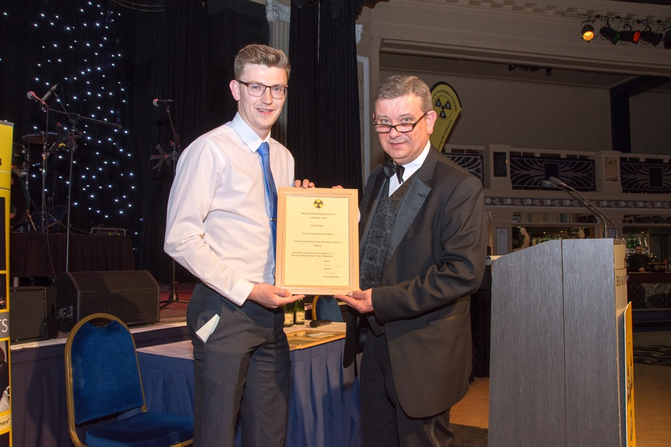 Alex Nicholson (Dstl) receiving YPA from Pete Cole, Immediate Past President (University of Liverpool)